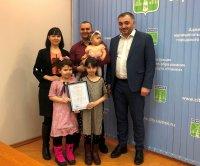 Усинские семьи получили соцвыплаты